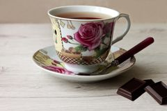 Fragrant hot tea with chocolate pieces close up royalty free stock image