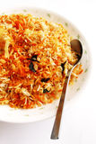 Fragrant Indian rice dish - bryani. A plate of fragrant Indian rice, nasi bryani, cooked with many spices and herbs, like saffron, cummin, coriander, clove Stock Images