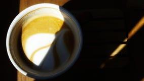 Fragrant morning cappuccino. A cup of coffee. stock photos