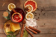 Fragrant mulled wine on a wooden table. Ingredients. Rustic stock photos