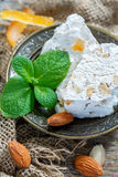 Fragrant nougat with almonds and candied orange. Stock Photography