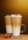 Fragrant сoffee latte in glass cup and cinnamon Royalty Free Stock Photos