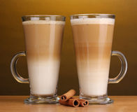 Fragrant сoffee latte in glass cups and cinnamon Stock Photo