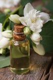 Fragrant oil of jasmine flowers macro vertical Royalty Free Stock Photography