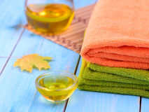Fragrant oil for the procedure and towel Royalty Free Stock Photos