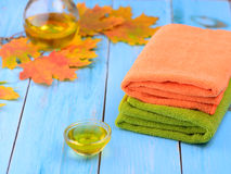 Fragrant oil for the procedure and towel Stock Image