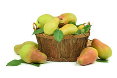 Fragrant pears in a wooden basket. isolated. royalty free stock photography