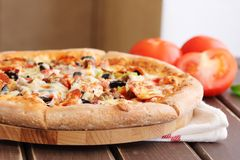 Fragrant pizza with vegetables on the board stock image