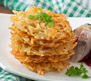 Fragrant potato pancakes and herring with beetroot Royalty Free Stock Photos