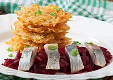 Fragrant potato pancakes and herring with beetroot Royalty Free Stock Photography