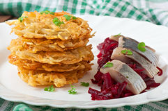 Fragrant potato pancakes and herring with beetroot Stock Photo