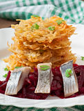 Fragrant potato pancakes and herring with beetroot Royalty Free Stock Images
