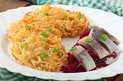 Fragrant potato pancakes and herring with beetroot Stock Photos