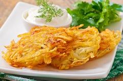 Fragrant potato pancakes with sour cream Royalty Free Stock Photos