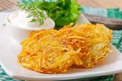 Fragrant potato pancakes with sour cream Royalty Free Stock Images