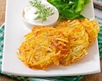 Fragrant potato pancakes with sour cream Royalty Free Stock Image
