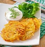 Fragrant potato pancakes with sour cream stock photo