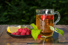 Fragrant raspberry tea. Healthy and tasty tea of raspberry leaves Royalty Free Stock Image