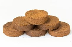 Fragrant and smooth rims with ground and pressed coffee machine. Discs pressed ground coffee from the coffee machine as a pyramid or pedestal winners Stock Images