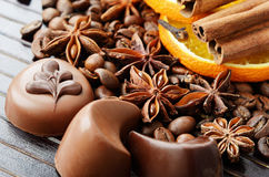 Fragrant spices, coffee and chocolate sweets Stock Photography