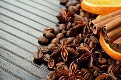 Fragrant spices, coffee and dry orange Stock Photos