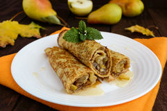 Fragrant sweet pancakes with caramelised pears Stock Photos