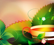 Fragrant tea. Cup of fragrant tea on a floral background Royalty Free Stock Image