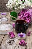 Fragrant tea and a branch of lilac Stock Photos