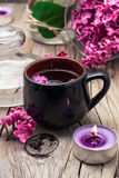 Fragrant tea and a branch of lilac Royalty Free Stock Photography