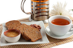 Fragrant tea and corn bread for breakfast Stock Images