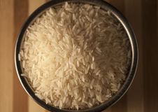 Fragrant Thai Rice. Steel pot filled with uncooked fragrant Thai rice Royalty Free Stock Photo