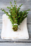 Fragrant thyme on cutting board Royalty Free Stock Photo