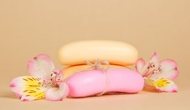 Fragrant toilet soap and the flower on a beige Stock Photo