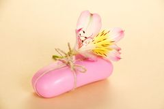 Fragrant toilet soap with a rope and flower Royalty Free Stock Photo