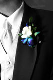 Fragrant tux. A colorful corsage on a grooms tux Stock Photo