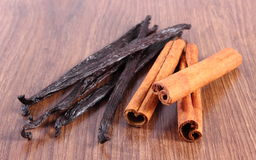 Fragrant vanilla and cinnamon sticks on wooden surface plank Stock Image