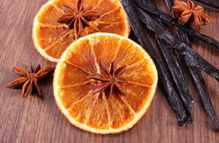 Fragrant vanilla, star anise and dried orange on wooden surface plank Royalty Free Stock Photos