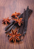 Fragrant vanilla and star anise on wooden surface plank Stock Photo