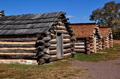 Fragua del valle, PA: Cabañas de madera del acampamento del invierno imagen de archivo libre de regalías