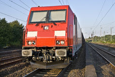 Fraight-train locomotive. Modern red locomotive for fraight trains is waiting for the next operation Stock Photo