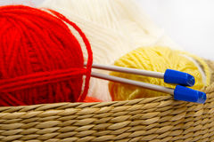 Frail of knitting tools. Frail full of multicilored balls and needles Royalty Free Stock Images