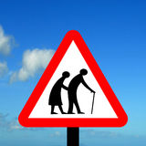 Frail pedestrians likely to cross road ahead. Frail (or blind or disabled if shown) pedestrians likely to cross road ahead Stock Photo