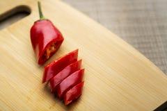 Frais rouge à un arrière-plan en bois Images stock