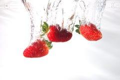 fraise d'éclaboussure image stock