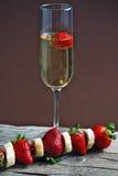 Fraises et champagne Photos libres de droits