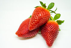 3 fraises sur le fond blanc, d'isolement Photographie stock libre de droits