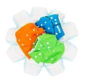 fraldas Eco-amigáveis e tecidos isolados no branco Fotografia de Stock