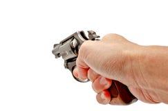 framåt trycksprutahandholding som pekar revolveren Fotografering för Bildbyråer