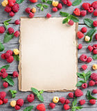 Fram from raspberries and mint leaf with beige background in the center. Close up, top view, high resolution product stock photo