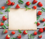 Fram from strawberry and mint leaf with beige background in the center. Close up, top view, high resolution product royalty free stock image